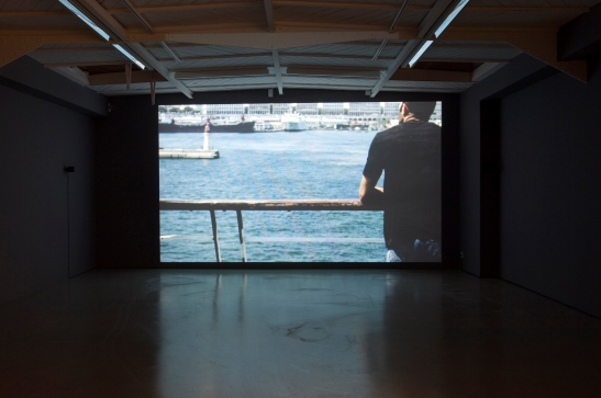 "Zineb Sedira, MiddleSea, 2008, video-projection, sound, film super 16 mm,16/9, 16 min, Vues de l'exposition ""Shipwreck : The Death of a Journey"", kamel mennour, Paris © Zineb Sedira Photo Marc Domage. Courtesy the artist and kamel mennour, Paris"