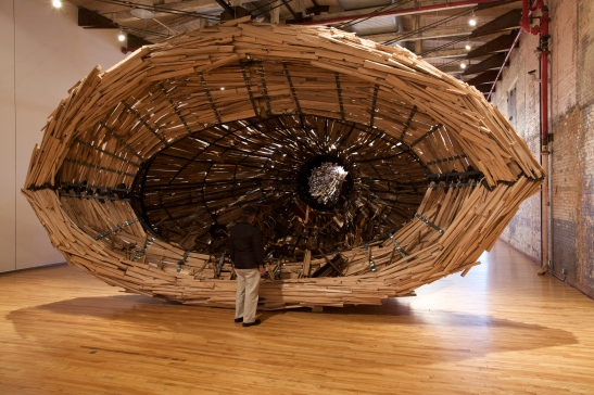 Nari Ward, Nu Colossus, 2011, boat, metal, wood, metal chimney, copper drum, furniture, plexiglas and rubber roofing membrane, 720 x 336 x 168 inches (approximately) 1828.8 x 853.4 x 426.7 cm. In collaboration with MassMoCA North Adams, MA. Courtesy the artist and Lehmann Maupin Gallery, New York