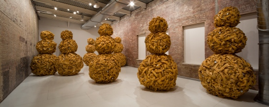 Nari Ward, Mango Tourist, 2011, foam, battery canisters, Sprague Electric Company resistors and capacitors, mango pits, 8 figures, each approximately 120 inches. Courtesy the artist and Lehmann Maupin Gallery, New York