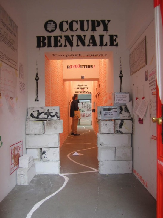 "Inside entrance to the KW Institute Contemporary Art during the 7th Berlin Biennale and installation shot of ""Global Square"" encampment. Image courtesy of the artist."