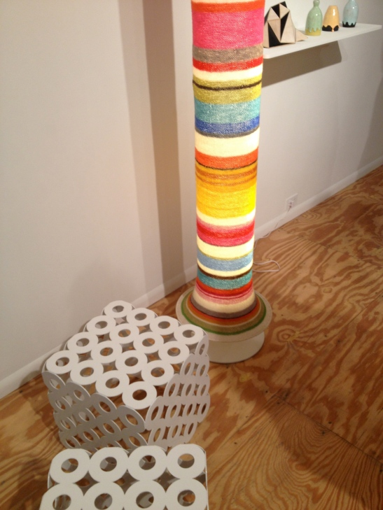 "Egawa-Zbryk, Sweater Lamp, 2003, yarn, steel, plastic, flourescent light. Egawa-Zbyrk, Cube, 2003, powder coated steel, 15""x15""x15"". Installation view. Image courtesy of Erin Dziedzic"
