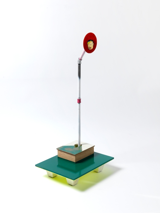 "Steve Locke, ""in the watching,"" 2013, egg tempera and oil on wood, attached to wood base with collage, milk paint, and enamel, beveled and painted on bottom with painted wood legs. With stripped and painted poles, connectors, and flanges. Image by Stewart Clements. Courtesy of the artist and SAMSON, Boston"